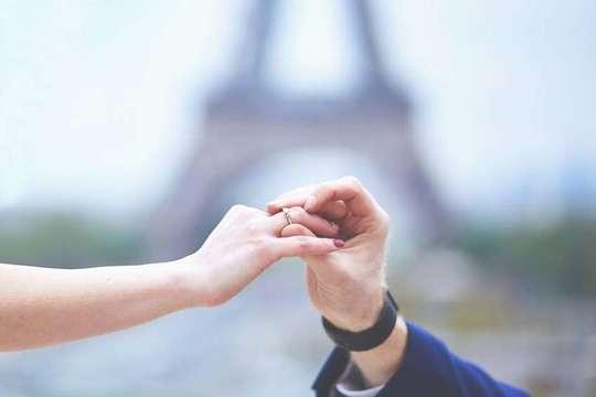 http://www.istockphoto.com/photo/happy-romantic-couple-in-paris-gm531798158-93957473